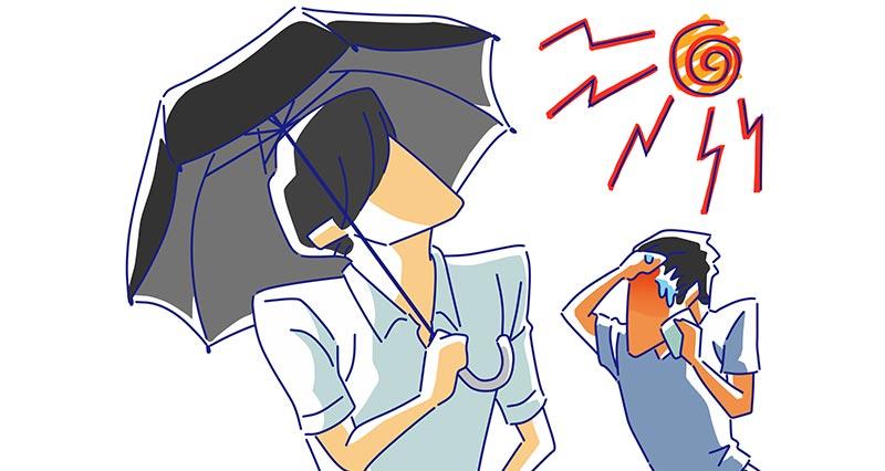 日傘を差す男性